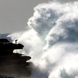 Impressive imagery of  man vs. giant waves at Australia's Bondi Beach.