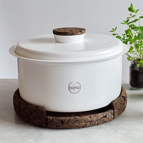 BONO Composter designed by Ala Sieradzka. Bono takes little effort to use, and can turn your organic waste into a nutrient-filled fertilizer that can be used to feed your plants.