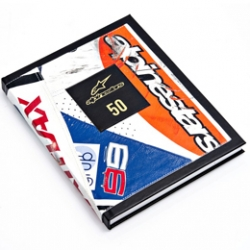 Prolific motorsports brand ALPINESTARS, 50 Year Anniversary book bound in the battle scarred, reclaimed leather of crashed motorcycle suits worn by World Champion Motorcycle racers.