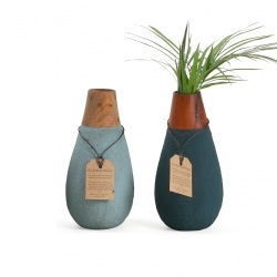 "These ""green"" vases are handmade in Sri Lanka from recycled paper and sand and are 100% waterproof. The wooden neck is made out of mahogany offcuts from the furniture industry."