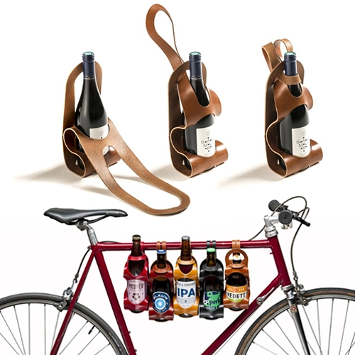 La Bouclée makes lovely, minimal, single piece leather bike carriers for your beer, wine, and more. Beautifully simple designs. (The 4 pack carriers look great too!)