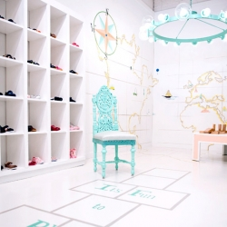 Designer Sharon Taylor decorated this children's store, Jellybeans, using materials from a local flea market and from eBay, transforming the space into a delicate boutique.