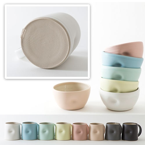 Emma Lacey Ceramics - Everyday Collection. Fine stoneware clay and is finished with beautiful, tactile satin matt glazes. Each piece is dented while the clay is still soft giving a sensual aesthetic and a form that is ergonomic to use.