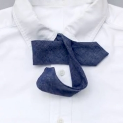 How To Tie a Bow Tie by Hickorees is a stop motion animation walking you through the steps of how to master this tricky tie. The animation is clever too.