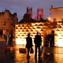 People Changing Places by DSDHA - Dezeen shows us the more than 1000 orange boxes stacked in a square in York, UK.
