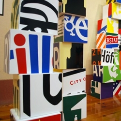 Artist Christopher Andrew Sisk presents an environment created of a chopped up collection of signs and graphics from the streets. Signs and boxes made boxes and signs!
