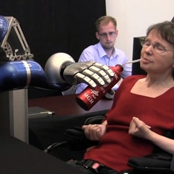 Braingate is a neural interface for controlling computers as well as physical devices. In this instance, a paralyzed woman is able to pick up her coffee and drink it by controlling a robotic arm with her thoughts.
