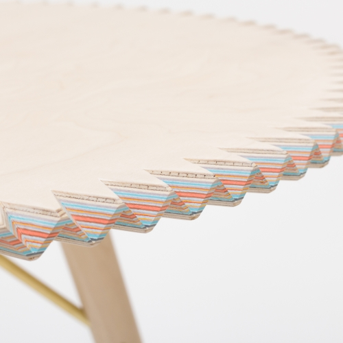 Breaking Surface Table by Sophie Hardy. The table made from 63 layers of coloured paper and birch ply, represents and talks about the hidden potential and concealed beauty that she believe exists in the layering of a multicultural community.