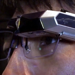 Video of a head mounted digital display by Brother Industries. It projects images directly onto the retina.