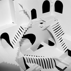 Bryan Peele's cut and fold paper model of Escher's Relativity made from a single paper and held together without tape or glue.