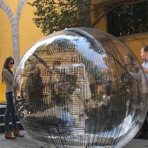Spheres of Influence by Curime Batliner and Jake Newsum for the Mextropoli Festival in Mexico City. Robot arms in bubbles! It employs a robotic system for layering grids of information, abstracted from the city, on a series of human size spheres.