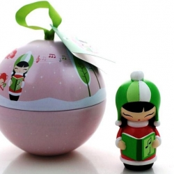 Designer Helena Stamulak has created this year's Christmas Momiji doll. 'Bubble' is a tiny carol singer packaged in a bauble tin. Hidden inside each doll there's a secret folded for a teeny message. Cute.