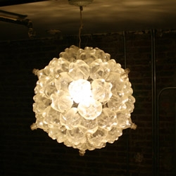 The Bubble Chandelier by New York based Shaun Kasperbauer is a light fixture made up of reused soda bottles.