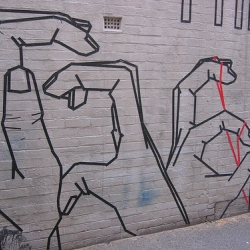 Australian artist Buff Diss trademark style of 100% legal masking tape street art
