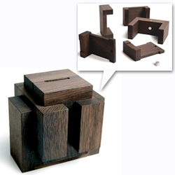'Kässeli' building blocks for future plans, by Brigitta and Benedikt Martig-Imhof for tät-tat. FSC certified smoked oak puzzle/saving box with a magnetic lock.