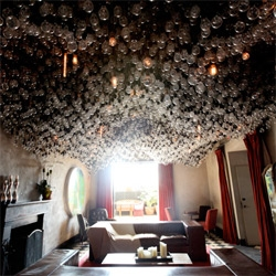 A peek at the insane lightbulb clusters covering the ceiling of a room at the Gramercy Park Hotel Roof Club!