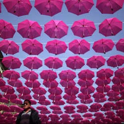 Two very different approaches to Breast Cancer Awareness Month: Umbrellas in Bulgaria; Flash mob in London. Both pink. Both fun.