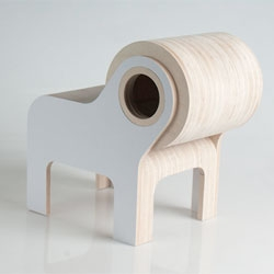 BULL, a piece of children's furniture by Andrew Lizaso that is a chair with the backrest like a giant spinning wheel that can be used as a basket or a trolley.