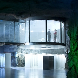 This crazy data-center in Stockholm was built in an old bunker, and designed to resemble a Bond villains lair.  I love the artificial waterfalls, the use of jungle plants on the stone walls and this cool circular viewpoint for watching the servers.