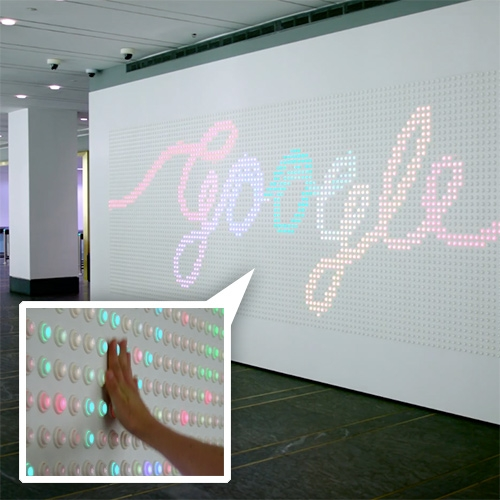 Google NYC lobby has an installation with 5880 arcade buttons as pixels! It uses AnyPixel.js - their open source software and hardware library which lets you use the web to create big, unusual, interactive displays out of all kinds of things.