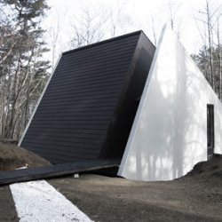 The C-2 House designed by Curiosity is like huge abstract shape rising from the ground with its shaped angle following the steep angle of the land. An unexpected and refreshing house!