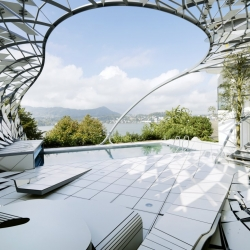Landscape Fence by Heri&Salli, a free-form steel 'cocoon' wrapped around a swimming pool in Austria.
