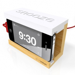 Distil Union's Snooze - The minimal wooden iPhone 4 alarm dock with big rubber snooze bar.