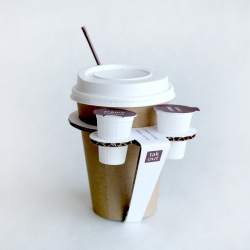 Using a simple piece of cardboard without any gluing, this coffee cup holder offers a nice service to the user carrying the standard milk cups and protecting the hand from the heat of the cup.