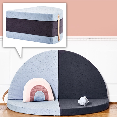 A Piece of Cake Mattress from Oyoy. Made of 100% organic cotton around compressed foam, with a leather handle. Sit on it as a piece of cake, unfold it into a semi-circle, or a full circle.