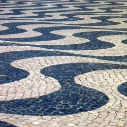 In Portugal, pavement is synonymous of art. Being usually used in sidewalks, it's in plazas and atriums that this tradition finds the  deepest expression.