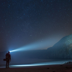 The newly designed TE14 Headlamp flashlight by Third Eye Headlamps lights up the cliffs at Sand Dollar Beach in Big Sur, California.