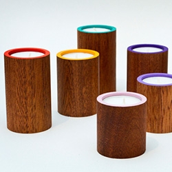 Gudrún Vald Gígur tea light holders made of mahogany wood and hand painted in a burst of bright matte colors.  Gígur is Icelandic for crater.