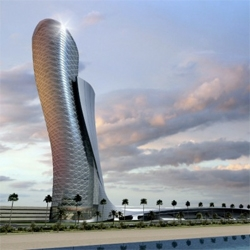 Capital Gate, the most leaning building in the world reached halfway point of construction. The building, designed by RMJM, leans 18º (4º more than the Pisa tower), supported by a steel exoskeleton.