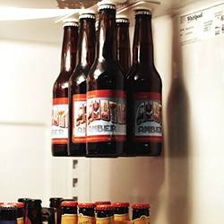 BottleLoft - great use of magnets to hang your beer from the top of the fridge instead of wasting shelf space. Great gif of holding a sixpack up and sliding the case off.