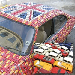 Presenting the General Carbuncle: one old Ford covered in 4500 toy cars
