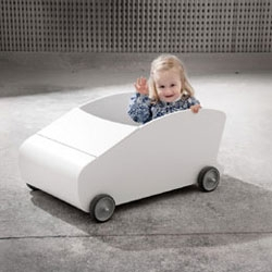 Pasila Design's Auto ~ The car is a multifunctional furniture, a toy, and a bed. Intended as a bed during the baby's first couple of months, as the baby can be rocked to sleep in the wheel-fitted car.