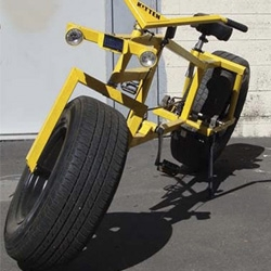 Gregory deGouveia has created a bicycle that rolls on two car wheels.