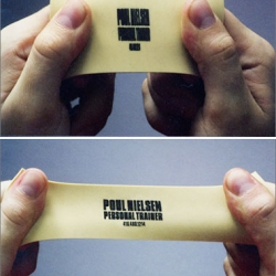 """business card for canadian personal trainer poul nielsen designed by publicis, toronto. the name card is difficult to read until it is stretched."""