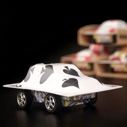 Racing Cards are pullback toy cars made of ordinary playing cards manufactured in a unique mold using heat and vacuum.