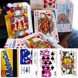 MetroDecks - nyc MTA subway cards upcycled into playing cards. Each card is hand screen printed, and sets are encased in beautiful letter pressed packaging. Face cards have nyc inspired designs!