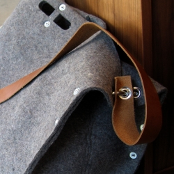 Rugged industrial wool-felt carryalls by designer, Mauro Bianucci.