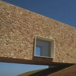Casa da Quinta, designed by Marcio Kogan - a minimalist stone house in the São Paulo countryside.