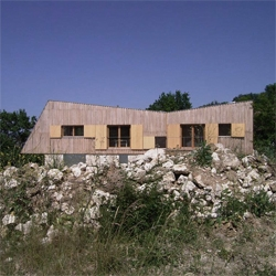 A small stone and wood house in the french countryside, by Meld Architecture.