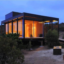 The Rodrigues Harvey House is a modern and simple house by Nicolas Loi of Loi Arquitectos.  Located in Tunquén, a coastal area in the central region of Chile, on a 5.000 square metre site overlooking the sea.