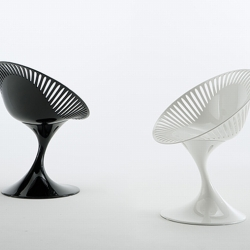 "Mew tables and chairs from Marcello Ziliani for Casprini. The chairs (called ""Azhar"") have a striking lacquer finish. The tables (""Atatlas"") have a similar base to the chairs and features an oval top."