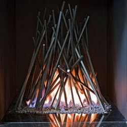 London based Cathy Azria creates art for the fireplace. This one is called Bonfire.