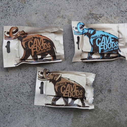 Cave Foods - Hand Crafted, Gluten Free, Primal and low in sugar performance bars with great wooly mammoth packaging! They come in vanilla, chocolate, and coffee flavors.