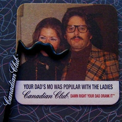 """Nice extension of Canadian Club """"Your Dad"""" campaign, with Mustache stir-sticks. Mustaches: so hot right now."""