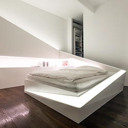 Who Cares? Design's ICE BED - quite the faceted bed/shelf/lighting system made of Corian.
