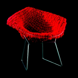 "What do you get when you take 576 public donated Comic Relief Red Noses and a Knoll Bertoia lounger. The answer is, ""The Chair That Grows""."
